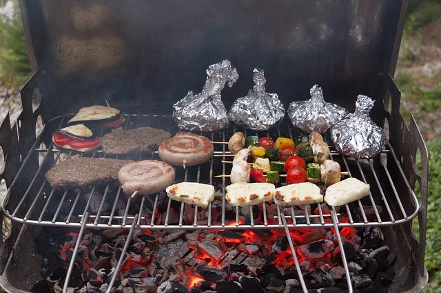 Charcoal Grill with meat and veggetables on it